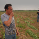 Farmers in rural China at grave of deceased migrant worker. ©BBC