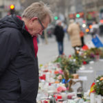 Reporter Peter Taylor at a shrine in Place de la Republique, Paris. ©BBC