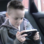 Child who took part in the experiment playing on PSP before the ban. ©BBC